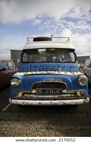 Old fashioned rusty camper-van rusts quietly on car park