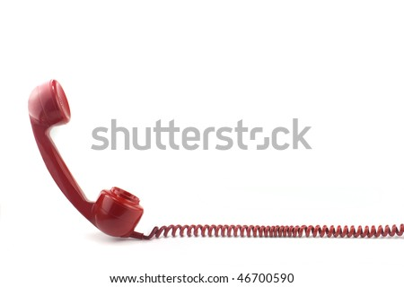 Old fashioned 1970's or 50's style red telephone