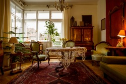 Old-fashioned sitting room with antique furniture