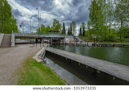 Old-fashioned sluice gates with Canal Tower and drawbridge at most popular freshwater canal in Asikkala (Vaaksy), Finland.