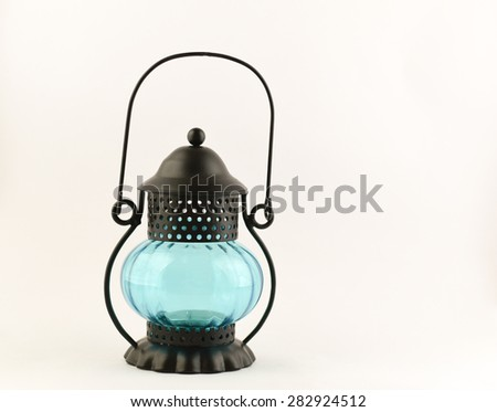 Old fashioned small size lantern isolated on white background, blue color lamp isolated on white backdrop