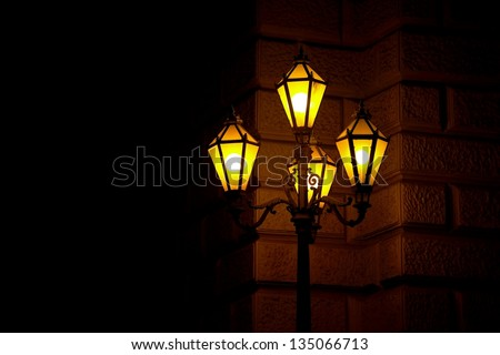 Old fashioned street lamp at night
