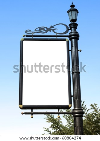 Old-fashioned street lantern with blank notice board - stock photo