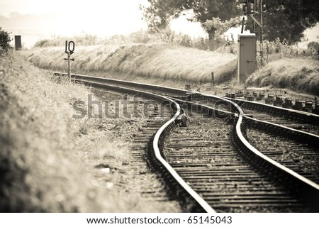 old fashioned styled rail tracks merging into one