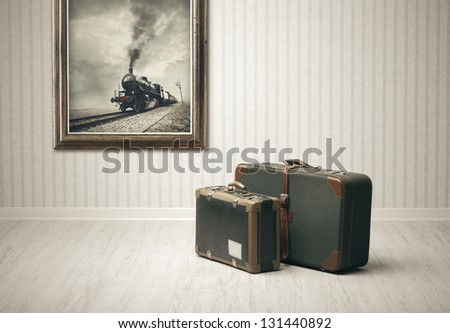Old-fashioned suitcases alone in a train station. Stock photo ©