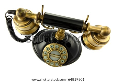 Old-fashioned telephone isolated on white background. Shallow depth of field. Studio work.