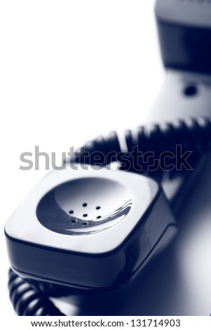 Old-fashioned telephone receiver - stock photo