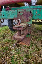 old fashioned trailer hitch on a tractor