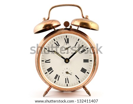 old-fashioned vintage copper alarm clock  against white