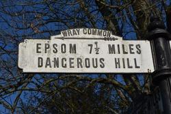 Old fashioned vintage roadsign danger warning for Epsom dangerous hill, UK