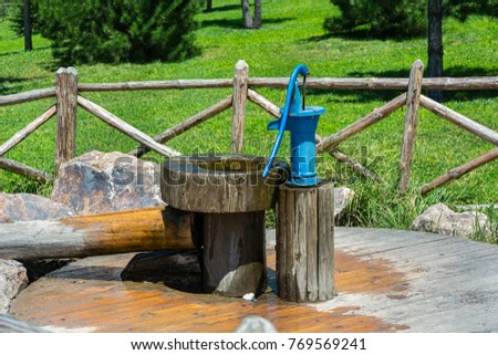 Hand Pump - color image of vintage/old fashion manual water well