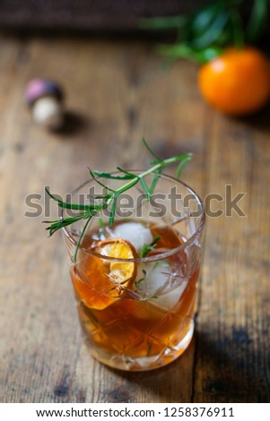 Old fashioned, whiskey drink with rosemary ice cubes #1258376911