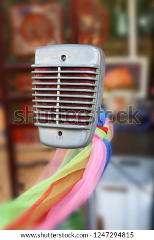 Old-fashioned wired microphone #1247294815