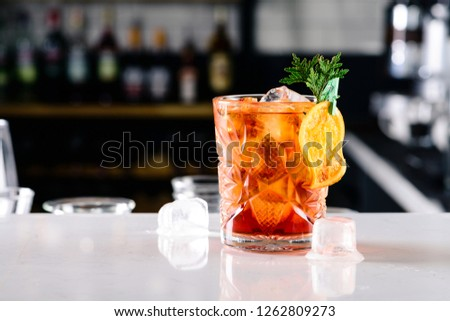 Old Fashioned with orange closeup on bar counter with copy space