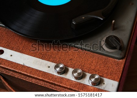 Old fashioned wooden disc player.