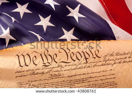 Old fashionet American Constitution with USA  Flag. - stock photo