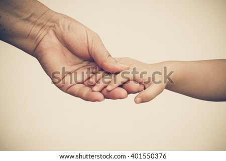 old female hand holding young...