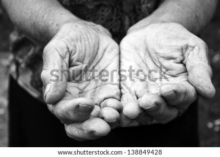 Old female hands in black and white