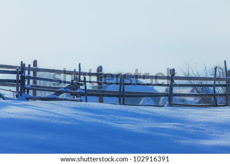 Old fence shadow in fresh snow #102916391