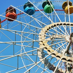 Old ferris wheel with multi-colored cabins in a city park of the city of Gryazi, Lipetsk region, Russia