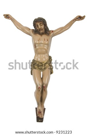 Old figurine of Jesus crucified, isolated on white