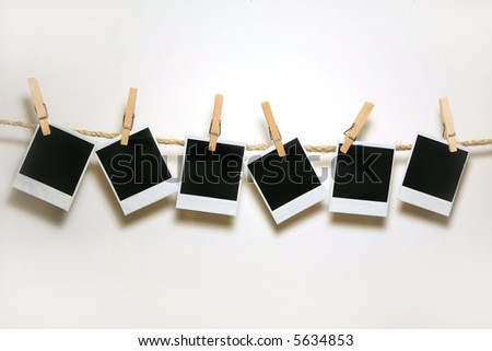 Old Film Blanks Hanging on a Rope Held By Clothespins - stock photo