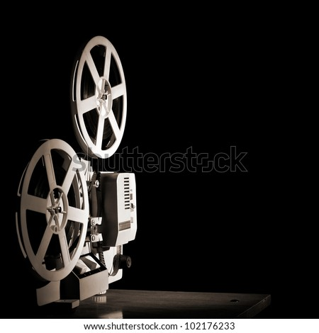 Old film projector on a black backgroun