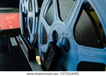 Old filmstrip ,Filmstrip with reel ,8 mm film with reel.