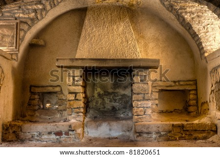 Old Fireplace in a Farmhouse Interior in Apulia, Italy