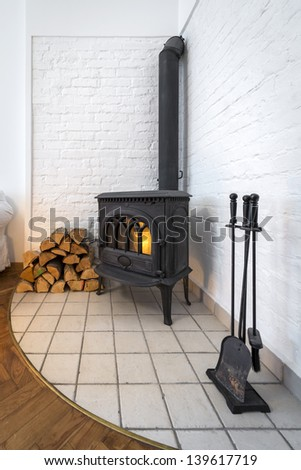 Old fireplace in modern interior design