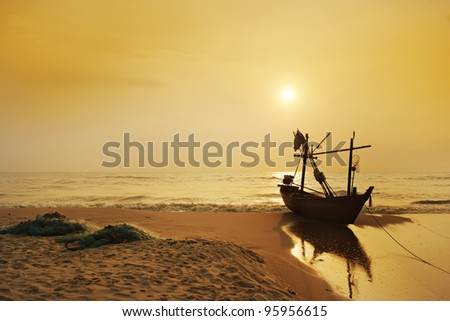 Old Fisherman boat at sunrise