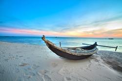 Old fisherman boat at sunrise time. Hue province. Vietnam