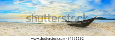 Old fisherman boat at the beach. Panorama