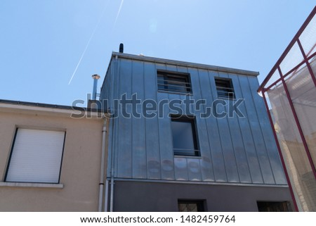 old fisherman house with a facade in metal cladding in Trentemoult city France