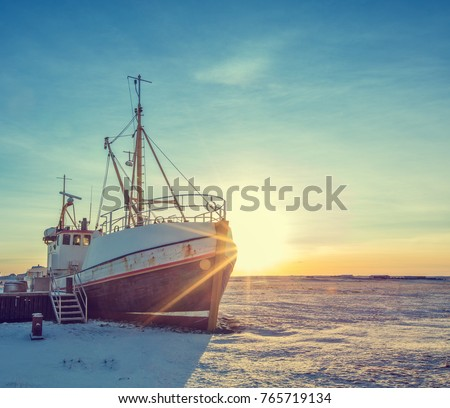 Old fisherman iron boat in Iceland, grunge colored design