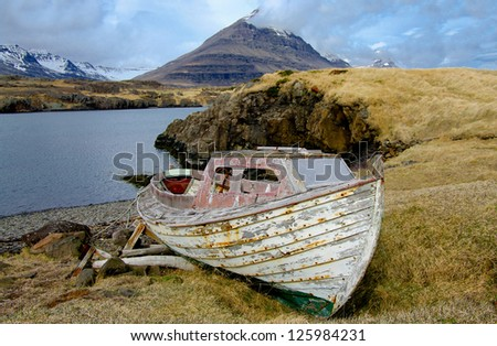 Old Fishing Boat:  A small, weathered boat rests on a remote shore in eastern Iceland.