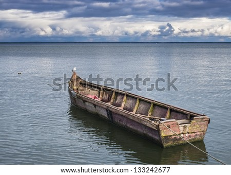 Old fishing boat at Curonian spit near village of Nida, Lithuania