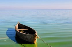 Old fishing boat floating on the water