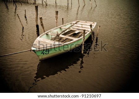 Old fishing boat in lake
