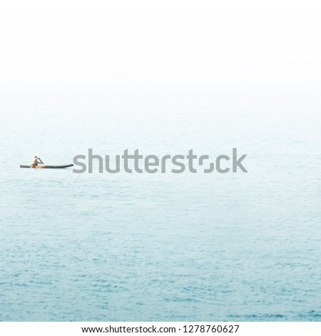 Old fishing boat on the sea. Indian ocean, India. Vacation or travel background in minimalist style. Minimalist concept. #1278760627