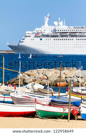 Old fishing boats and cruise ship