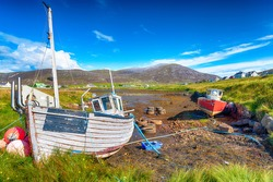 Old fishing boats at Leverburgh on the Isle of Harris in the Western Isles of Scotland