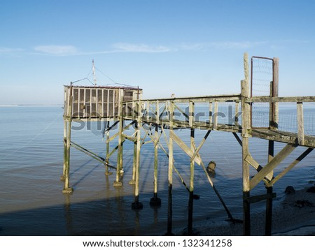 Old fishing cabin and carrelet net, estuary of Gironde, Medoc, France.