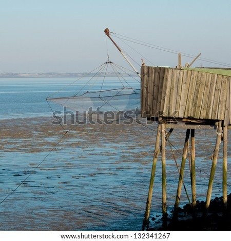 Old fishing cabin and carrelet net, Medoc, France.