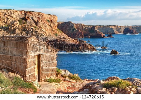 Old fishing hut lodge on the beach. Portugal, Sagres.