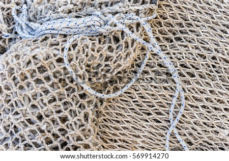 Old fishing net. #569914270