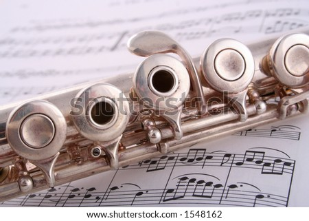 Old Flute close up across sheet music