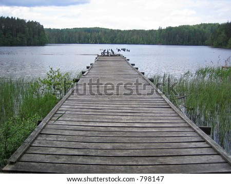 Old foot-bridge in the lake