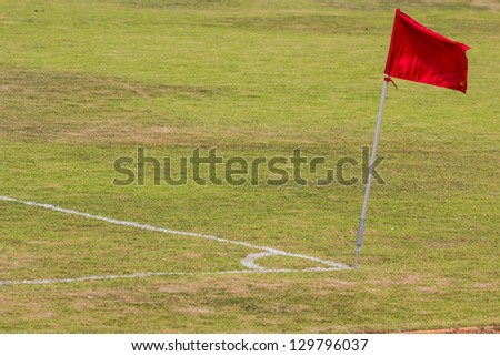 old football field with red flag.