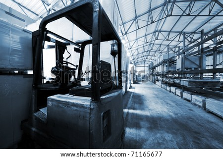 old forklift in a large modern warehouse